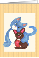 Cat and chocolate bunny with egg